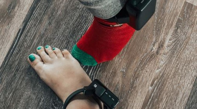 A Kentucky couple required to wear ankle monitors following their questioning of Health Dept requirements for CV
