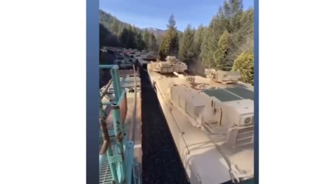 hundreds of battle tanks and military equipment filmed in Sacramento, California being transported by rail to a destination unknown (Video: Cairns News)